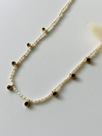 Collier doré et perle naturelle