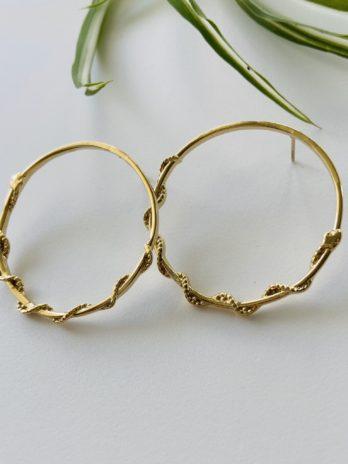 Boucles d'oreilles dorées serpent